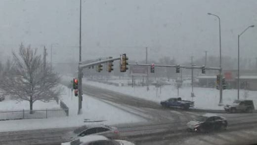 Snowfall at 11:34 a.m. Monday at 10th Street and Minnesota Avenue in Sioux Falls.
