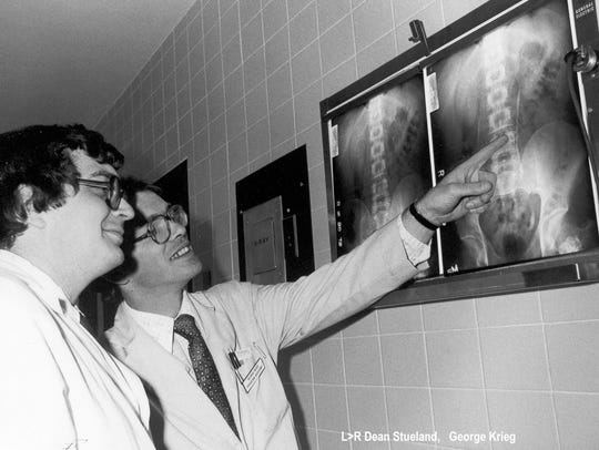 Dean Stueland, right, looks at an X-ray