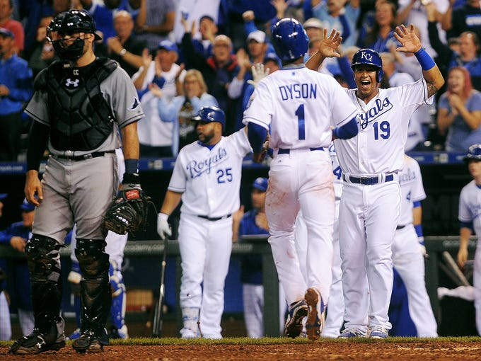 Kansas City's Jarrod Dyson (1) is greeted by teammate