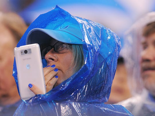 A Kansas City fan uses a mobile phone during a game