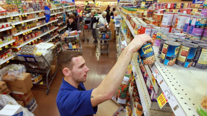 "Ohio and Kentucky laws don't explicitly ban the ""open carry"" of firearms at private businesses, like the Kroger Marketplace in Newport."