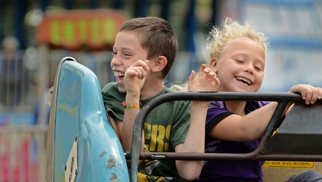 File - Amusement rides are one of the Mishicot Riverfest staples.