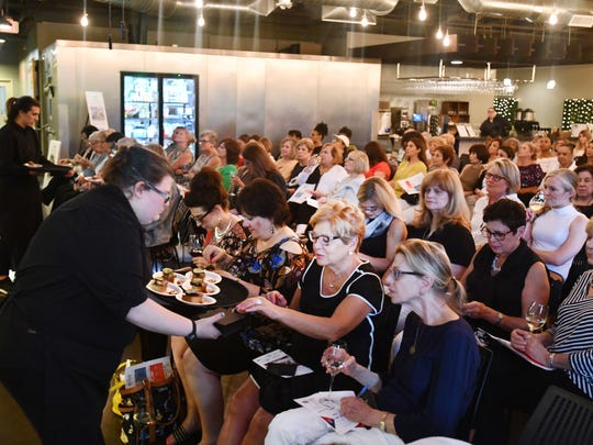 Guests are treated to smokey goodness from Chef Jeremy Grandon of J Bird Smoked Meats.  Detroit News Homestyle's Dish and Design Red, White and BBQ at the Great Lakes Culinary Center in Southfield, Michigan on June 27, 2018.