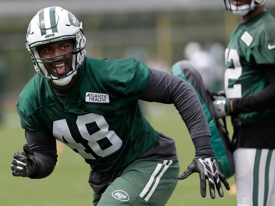New York Jets' Jordan Jenkins runs a drill during the team's organized team activities at its NFL football training facility, Tuesday, May 23, 2017, in Florham Park, N.J. (AP Photo/Julio Cortez)