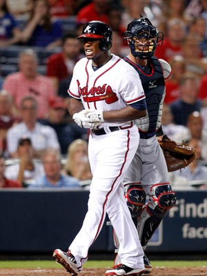 Atlanta Braves left fielder Justin Uptonreacts after he is hit by a pitch against the Cleveland Indians in the fifth inning at Turner Field.