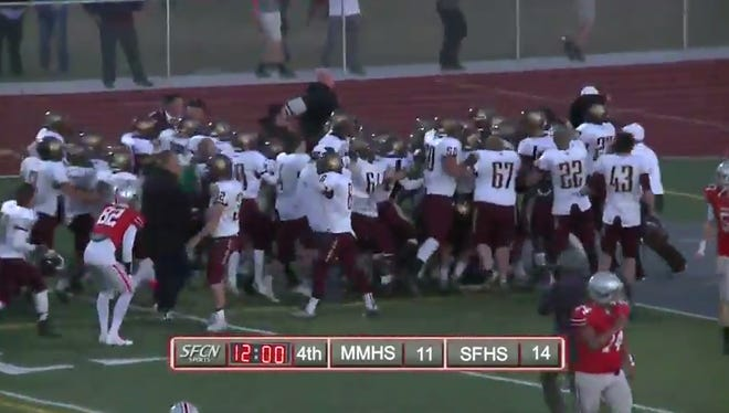 Maple Mountain players celebrate after defeating Spanish Fork on an improbably play to end the game.