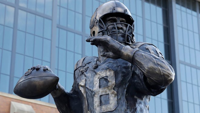 The Peyton Manning statue is seen outside of Lucas Oil Stadium, Saturday, Oct. 7, 2017, in Indianapolis. (AP Photo/Darron Cummings)
