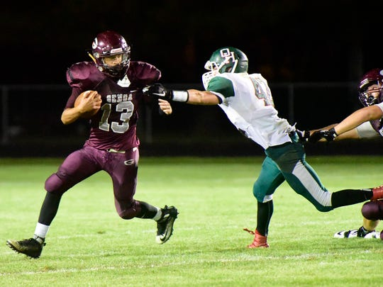 Genoa's Josiah Bradfield, left rushing against Oak Harbor, scored a touchdown last week against Perkins.