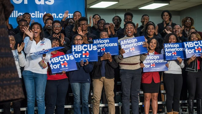 Supporters with African Americans for Hillary.