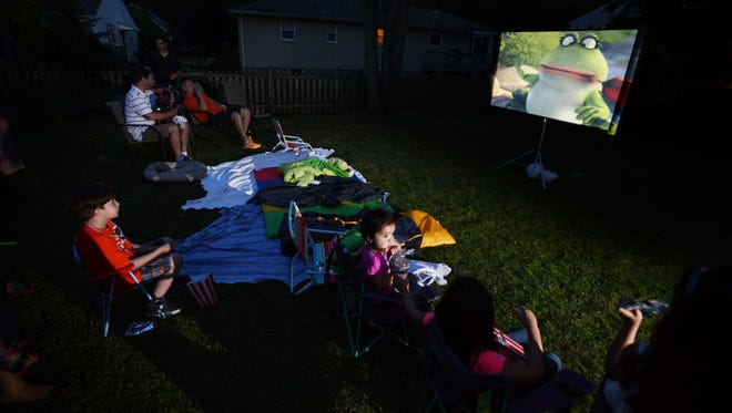 This is a movie night in reporter Kara Yorio's backyard with a projector, screen and snacks.