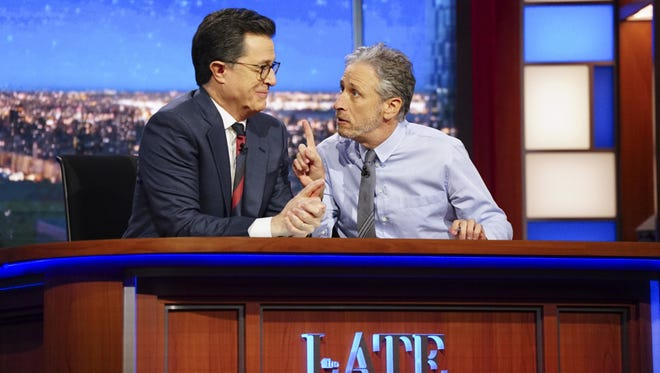 """Jon stewart stopped by """"the Late Show with Stephen Colbert"""" to talk President Trump and the media."""