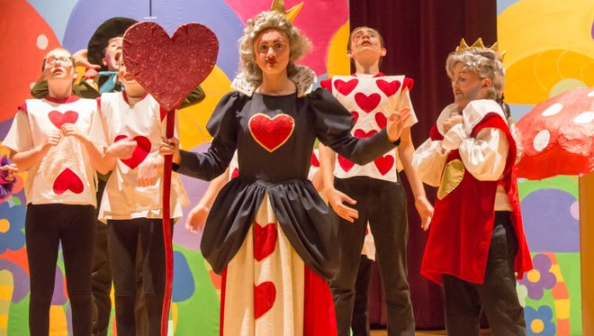 """CET students perform """"Alice in Wonderland"""" at the Salem Public Library."""