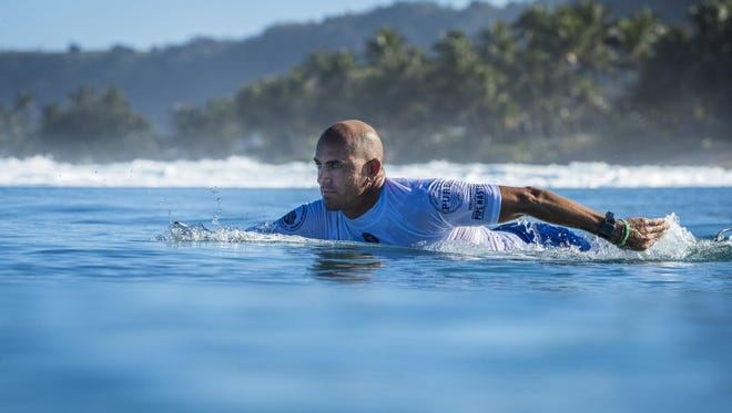 Kelly Slater paddling at the 2017 Pipe Masters in Oahu. Hawaii.