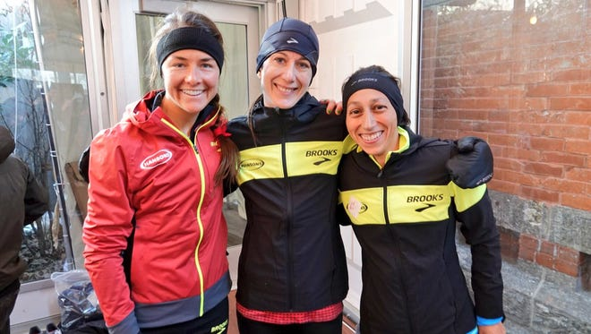Danna Herrick (left), with Hansons-Brooks teammates Dot McMahan (center) and Desi Linden at NYC Half in New York on March 18.