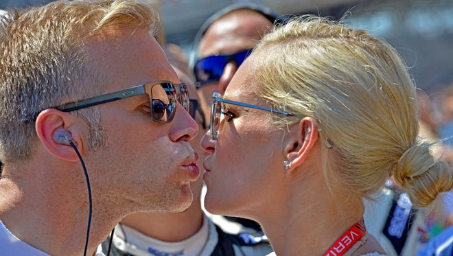 Ed Carpenter kisses his wife, Heather, before the start of the 102nd running of the Indy 500 on Sunday at Indianapolis Motor Speedway.
