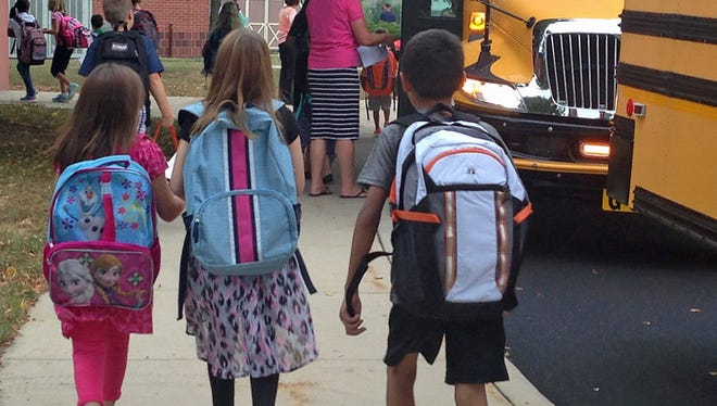 In this file photo from 2016, students exit the bus and head to classes at South Hamilton Elementary School in Chambersburg.