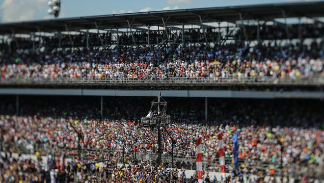 Fans watch the start of the 102nd running of the Indy 500 at Indianapolis Motor Speedway on Sunday, May 27, 2018.