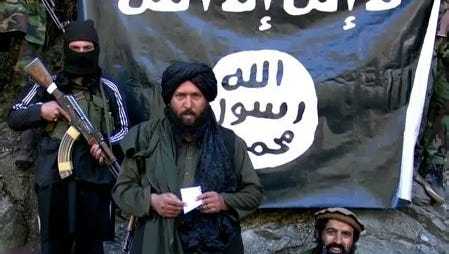 An image made from a video released by the Islamic State in 2015 purportedly shows Hafiz Sayed Khan, center,  head of the IS branch in Pakistan and Afghanistan, at an undisclosed location at Pak-Afghan border.