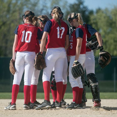 The Pacelli softball team huddles on the mound during the Central Wisconsin Conference 8 softball game at Spud Field at Woyak Park in Plover, Friday, May 22, 2015.