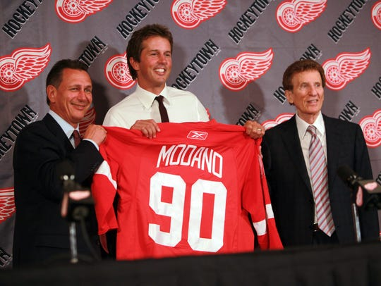 Ken Holland, Mike Modano and Mike Ilitch.
