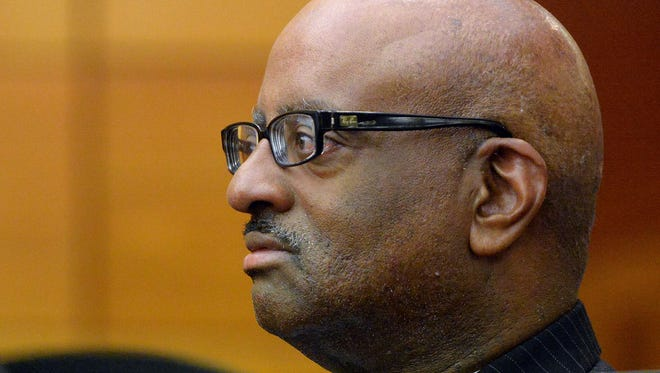 Michael Pitts, former Atlanta Public Schools school reform team director, listens April 13, 2015, to his daughter Kristen during a statements during sentencing of 10 of the 11 defendants convicted of racketeering and other charges in the Atlanta Public Schools test-cheating trial in Fulton County Superior Court in Atlanta.
