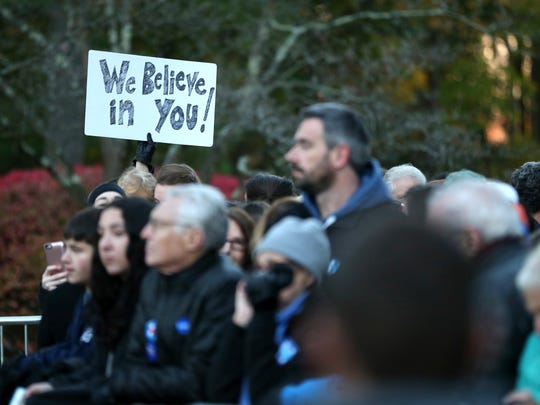 Supporters wait to greet Democratic presidential candidate Hillary Clinton at her polling place in Chappaqua, N.Y., Tuesday, Nov. 8, 2016.