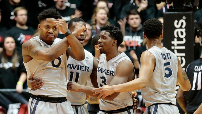 Xavier Musketeers forward Tyrique Jones (0) throws up the X to his teammates after drawing a foul.