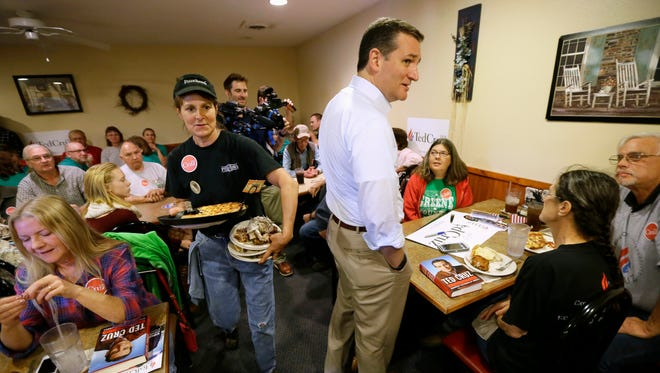 Republican presidential candidate, Sen. Ted Cruz, R-Texas, talks with local residents at a Pizza Ranch — a campaign stop staple and common expenditure for presidential candidates.