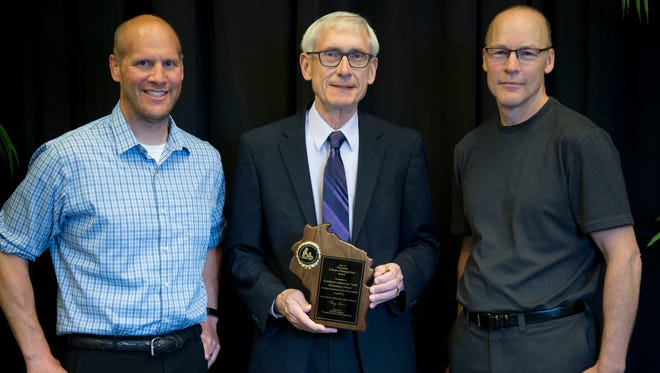 State Superintendent Tony Evers, center, presented the Wisconsin Title I School of Recognition to Gillett Elementary second grade teacher Brian Tesch, left, and first grade teacher Michael Collins during the May 21 ceremony at the State Capitol in Madison.