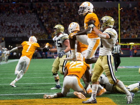 Tennessee players celebrate after winning the Chick-fil-A