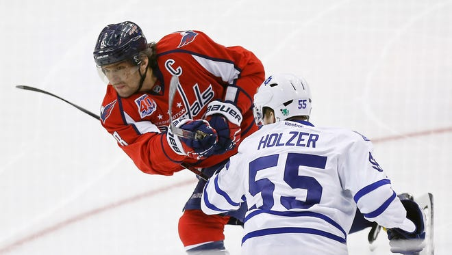 Alex Ovechkin scores a goal as Maple Leafs defenseman Korbinian Holzer defends in the first period.