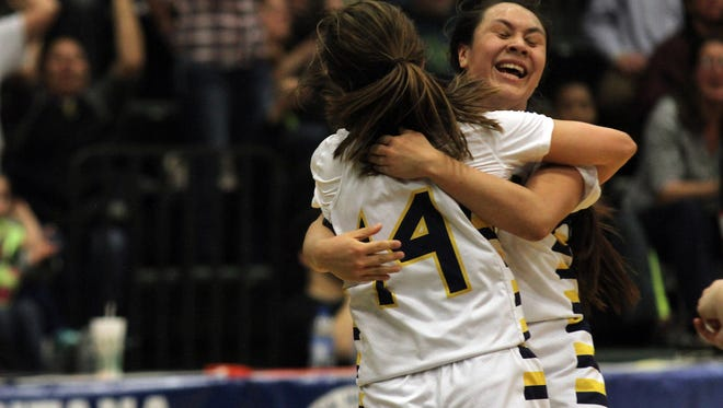 The Box Elder Bears celebrate after defeating Twin Bridges in overtime Thursday.