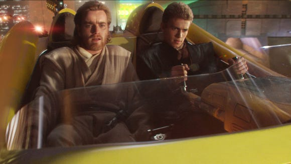 Obi-Wan Kenobi (Ewan McGregor) and Anakin Skywalker (Hayden Christensen) chase a bounty hunter in 'Attack of the Clones.'