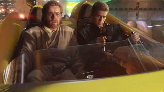 Obi-Wan Kenobi (Ewan McGregor) and Anakin Skywalker (Hayden Christensen) chase a bounty hunter in 'Attack of the Clones.'