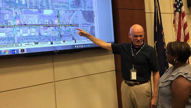Canton Township director of municipal services Tim Faas discusses how the Ford Road boulevard project would be implemented to township trustee Sommer Foster.
