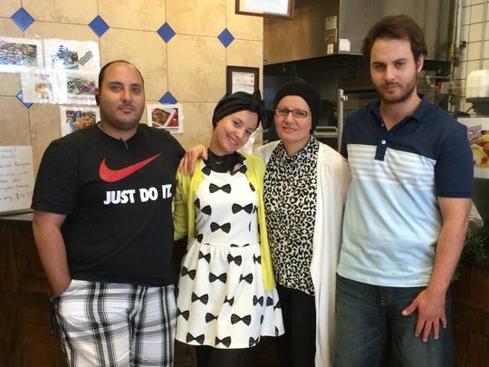 The Hussein family took over Opa! Mediterranean Gourmet in Fort Myers in September. Mother Nawal Hussein is second from the right, with her son Joey, left, daughter Asma'a and son Leo.