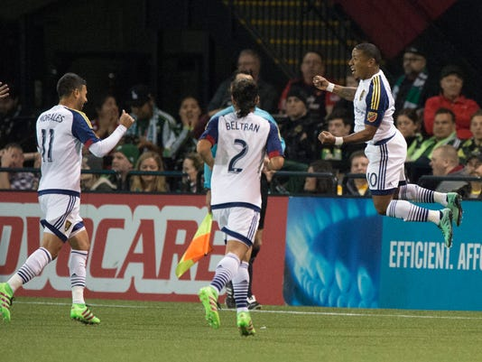 Real Salt Lake forward Joao Plata (10) celebrates after scoring a goal during the first half against the Portland Timbers during an MLS soccer game at Providence Park in Portland, Ore., Saturday, March 19, 2016. (AP Photo/Troy Wayrynen)