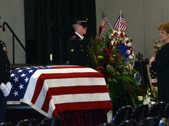 Sara Strother, mother of the late National Guardsman David Strother, looks at her son's casket Wednesday during a visitation in the Alexandria Riverfront Center.
