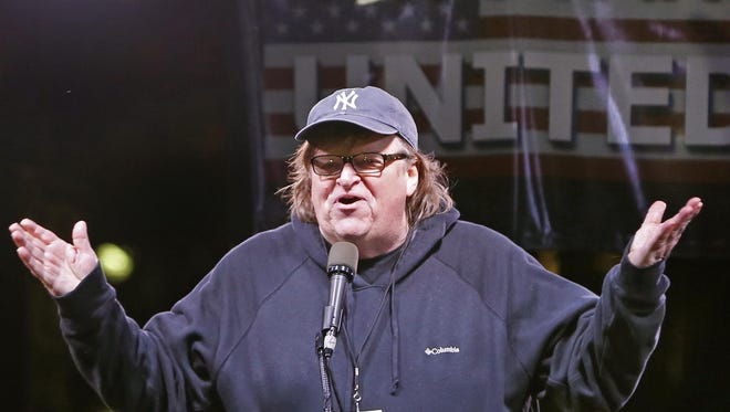 This Jan. 19, 2017, file photo shows filmmaker Michael Moore speaking to thousands of people at an anti-Trump rally and protest in front of the Trump International Hotel in New York.