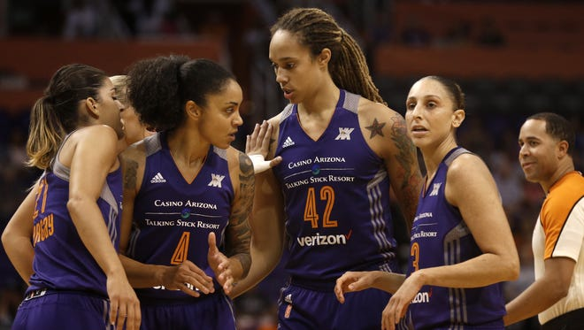 Phoenix Mercury's Brittney Griner (42) is congratulated by teammates after scoring against the Dream at Talking Stick Resort Arena on September 11, 2016 in Phoenix.