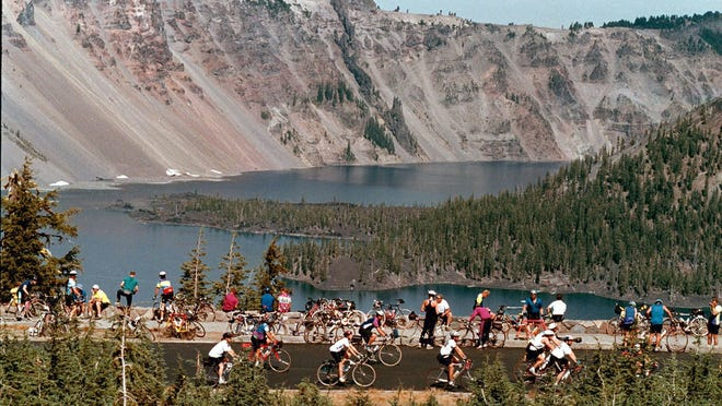 Cyclists can ride the rim of Crater Lake for the next two weeks without worrying about cars due to a lack of snow this season and warm spring temperatures.