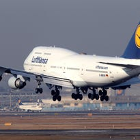 This file photo from Feb. 22, 2012, shows a Lufthansa Boeing 747 landing in Frankfurt, Germany.