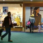 """Airport passengers pass by Norm Thompson retail outlet at Portland International Airport in Portland, Oregon. The Federal Trade Commission announced this week that two companies have agreed to refund $1.5 million to consumers who purchased """"shapewear"""" that supposedly can reduce cellulite and fat because it's infused with caffeine, vitamin E and other things."""