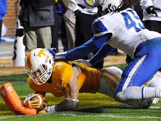 Tennessee running back Jalen Hurd (1) gets the ball