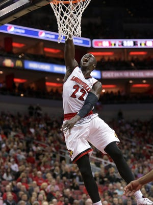 Louisville's Deng Adel slams home two points during second half action against Boston College. Adel, scoreless in the first half, came alive in the second half, scoring 18 points. Jan. 21, 2018.
