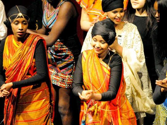 Students in Somali clothing exhibit a traditional dance