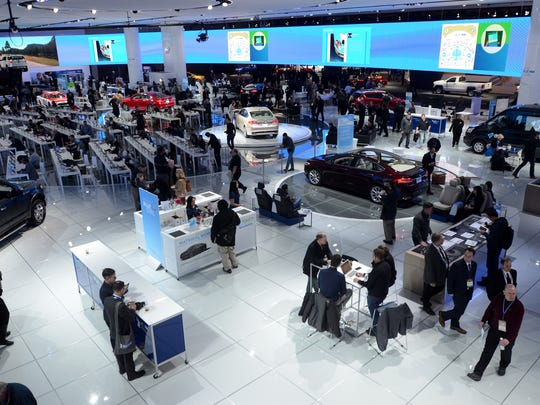 Event goers travel through the Ford exhibit Tuesday, Jan. 12, during the North American International Auto Show at Cobo Hall.