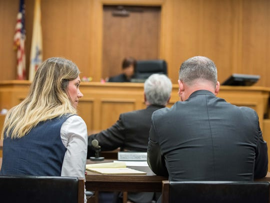 Assistant Monmouth County prosecutors, Meghan Doyle and Christopher Decker confer during the motion hearing for change of venue in the trial of  Liam McAtasney  charged with the murder of Sarah Stern. Judge Lisa P. Thorton issued a denial.