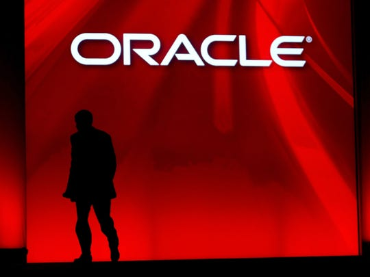 Oracle's then-CEO Larry Ellison walks off stage after delivering his keynote address at the 2008 Oracle OpenWorld conference in San Francisco.