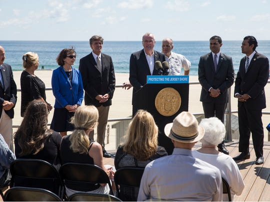 Gov. Phil Murphy signs legislation banning smoking at public beaches and parks during a visit to the Long Branch boardwalk.
